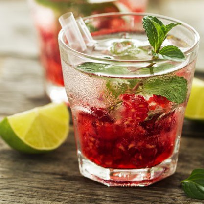 tasty-cold-fresh-drink-lemonade-with-raspberry-mint-ice-lime-glass-wooden-background-closeup_1220-1339